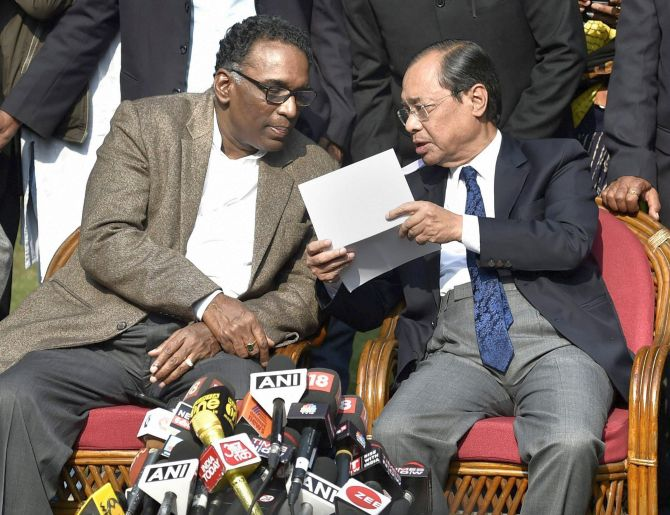 Supreme Court Justice Ranjan Gogoi, right, confers with Supreme Court Justice Jasti Chelameswar at the January 12 press conference in New Delhi. Photograph: Ravi Choudhary/PTI Photo