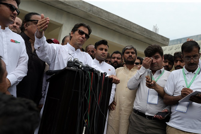 Imran Khan speaks to the media after casting his vote in Islamabad, July 25, 2018. Photograph: Athit Perawongmetha/Reuters