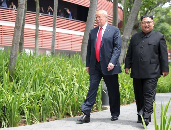 After their working lunch, United States President Donald J Trump and North Korean leader Kim Jong Un take a brief stroll around the Capella Hotel in Singapore, June 12, 2018. Photograph: Jonathan Ernst/Reuters