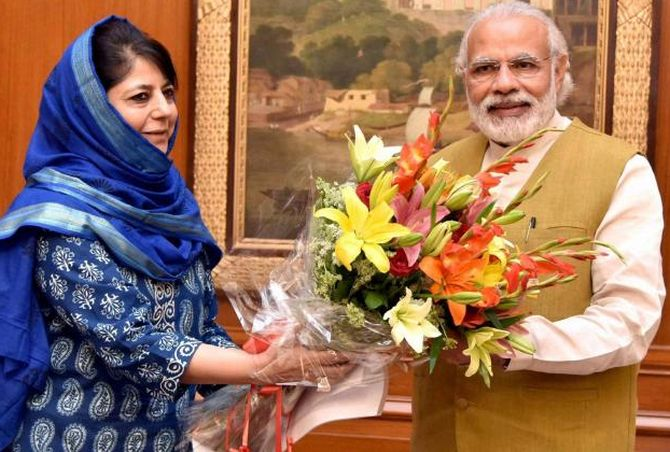 Mehbooba Mufti, then Kashmir's chief minister, heading a PDP-BJP alliance government, with Prime Minister Narendra Damodardas Modi. Photograph: PTI Photo