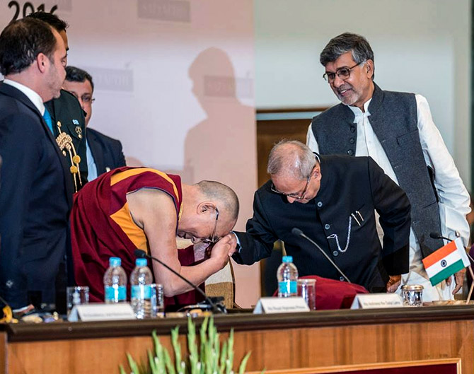 The Dalai Lama greets then President Pranab Mukherjee at the first Laureates and Leaders for Children Summit in Rashtrapati Bhavan, Dece,ber 10, 2016. Photograph: Kind courtesy@Office of Dalai Lama