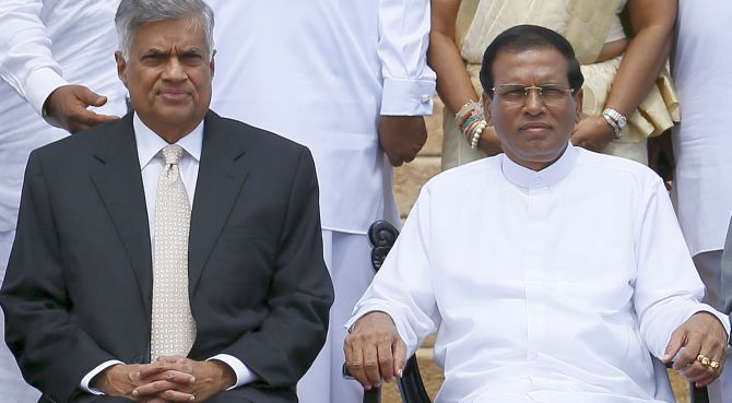 Sri Lankan President Maithripala Sirisena, right, with ousted prime minister Ranil Wickremesinghe. Photograph: Dinuka Liyanawatte/Reuters