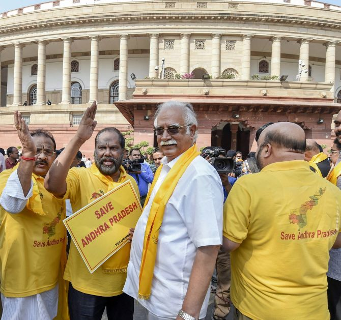 TDP MPs, including former civil aviation minister Ashok Gajapathi Raju, protest outside Parliament demanding special status for Andhra Pradesh, March 9, 2018. Photograph: Kamal Singh/PTI Photo