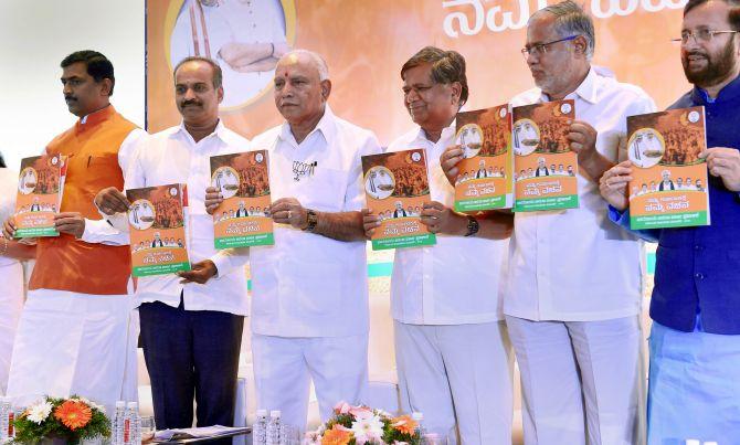 BJP's Karnataka manifesto promises farm loan waiver, cow protection commission