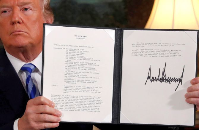 US President Donald J Trump holds up a proclamation declaring his intention to withdraw from the Iran nuclear agreement, May 8, 2018. Photograph: Jonathan Ernst/Reuters