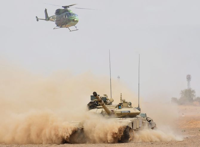 An Indian Army helicopter and tank in coordinated action practice the Air Cavalry concept during the Vijay Prahar exercise at the Mahajan field firing range in Rajasthan, May 2018. Photograph: PTI Photo