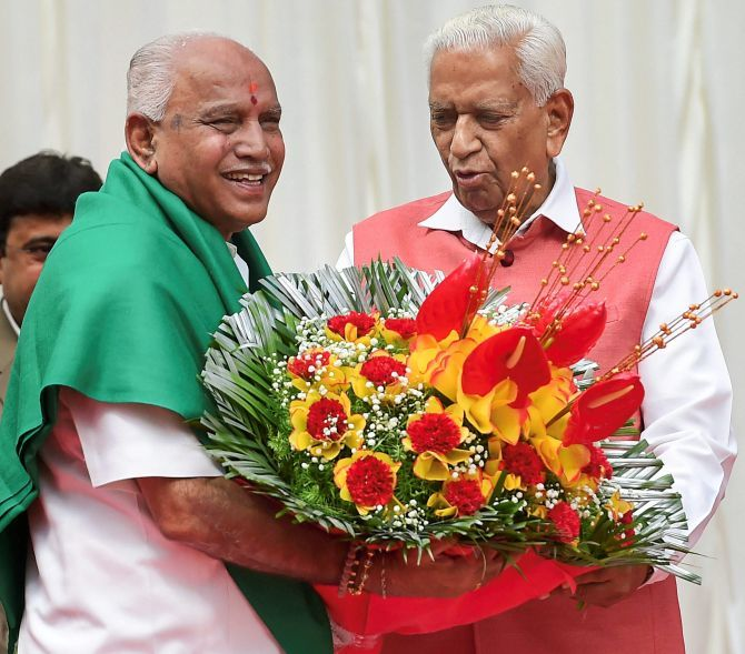 B S Yeddyurappa after being sworn in as Karnataka chief minister, May 17, 2018, with Governor Vajubhai Vala, right. Photograph: Shailendra Bhojak/PTI Photo