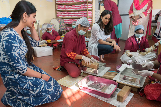 Suhani Jalota, left, with Meghan Markle and the staff at the Myna Mahila Foundation