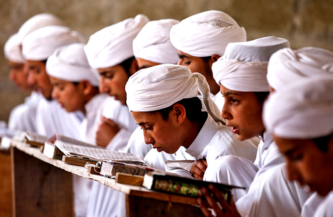 Young boys study at a madrasa
