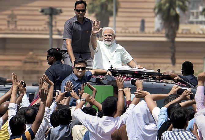 Prime Minister Narendra D Modi waves to crowds while inaugurating the first phase of the Delhi-Meerut Expressway. Photograph: Ravi Choudhary/PTI Photo