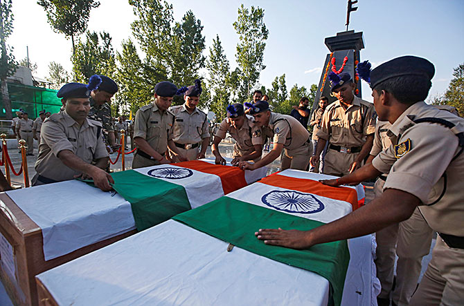 The coffins of two policeman killed in a militant attack in South Kashmir in July