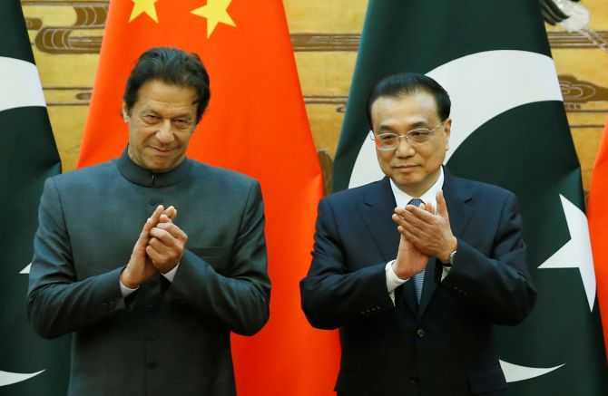 Pakistan Prime Minister Imran Khan, left, and China's Premier Li Keqiang at the Great Hall of the People in Beijing. Photograph: Jason Lee/Pool/Reuters