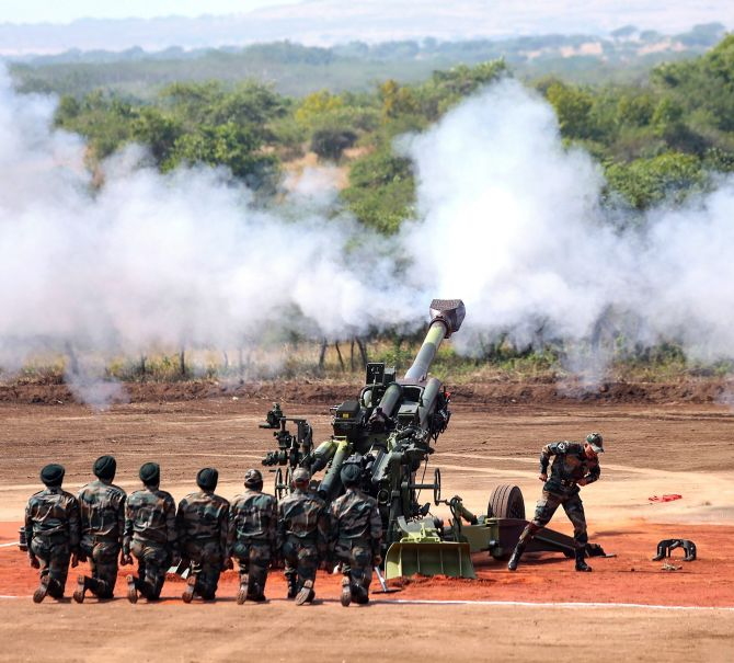 IMAGE: M777 Howitzer gun fires in the air. Photograph: PTI Photo
