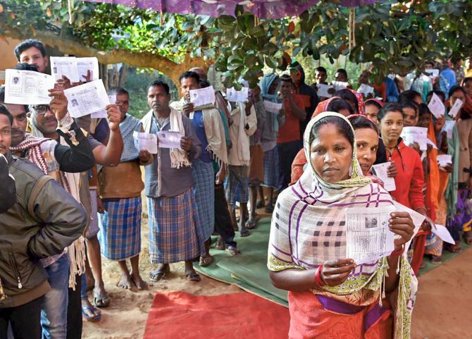 Voters wait in queues to cast their votes during the first phase of assembly elections in Chhattisgarh at a polling station in Narayanpur, November 12, 2018. Photograph: PTI Photo