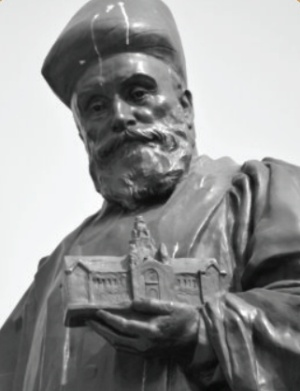 Statue of Jamsetji Tata holding a replica of the Main Building
