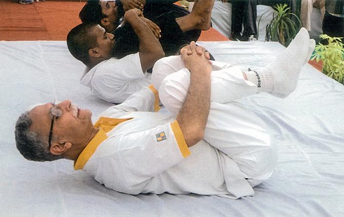 Lt Gen Zameer Uddin Shah, PVSM, SM, VSM (Retd) does yoga at AMU