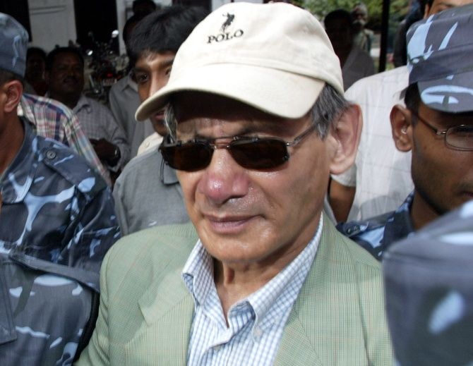 Serial killer Charles Sobhraj emerges from the Kathmandu district court after being sentenced to life in prison for his crimes