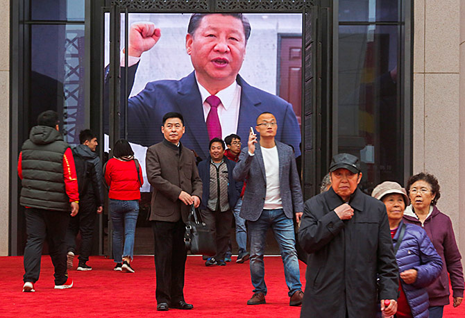 A screen shows President Xi Jinping at an exhibition marking the 40th anniversary of China's reforms at the National Museum of China in Beijing, November 14, 2018. Photograph: Thomas Peter/Reuters