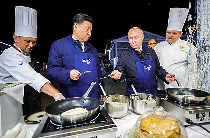 Xi and Russian President Vladimir Putin make pancakes during a visit to the Far East Street exhibition on the sidelines of the Eastern Economic Forum in Vladivostok, Russia, September 11, 2018. Photograph: Sergei Bobylev/TASS/Pool via Reuters