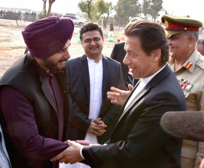 Pakistan Prime Minister Imran Khan with his old cricket rival Navjot Singh Sidhu at the groundbreaking ceremony for the proposed Kartarpur corridor. Photograph: PTI Photo