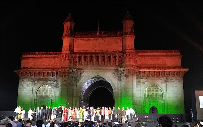 Dignitaries gather on stage to sing the National Anthem at the Indian Express concert that honoured victims of the Mumbai 26/11 attacks ten years later. Photograph: Vaihayasi Pande Daniel/Rediff.com.