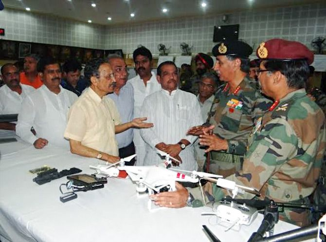 Major General B C Khanduri (retd), left in yellow bush shirt, chairman, parliamentary standing committee on defence, interacts with army officers during the committee's visit to the Northern Command Headquarters in Udhampur, Jammu and Kashmir, May 30, 2015.