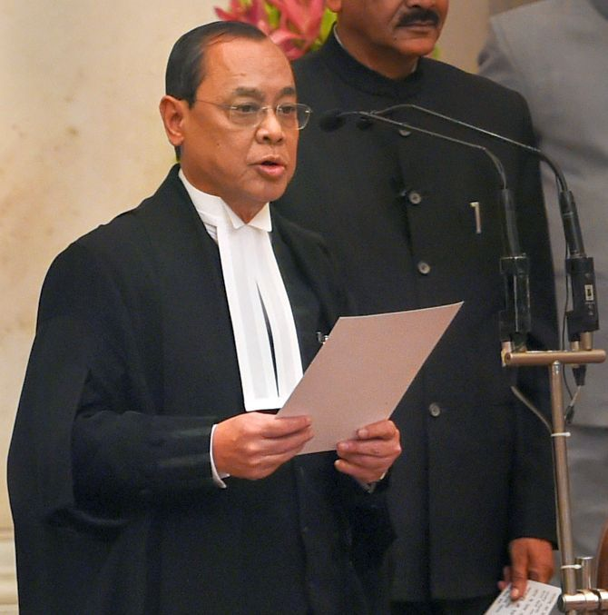 Justice Ranjan Gogoi takes his oath of office as the 46th Chief Justice of India at Rashtrapati Bhavan, October 3, 2018. Photograph: Shahbaz Khan/PTI Photo