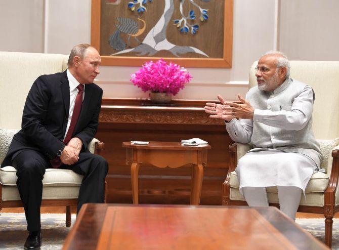 Russian President Vladimir Putin meets Prime Minister Narendra Damodardas Modi in New Delhi