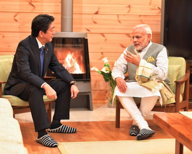 'Tete-a-tete in front of a fireplace,' the ministry of external affairs tweeted as Japanese Premier Shinzo Abe in a special gesture hosted Prime Minister Modi at his personal villa near Lake Kawaguchi in Yamanashi for a private dinner. It is the first time that Abe has invited a foreign political leader to his holiday home. Photograph: @MEAIndia/Twitter