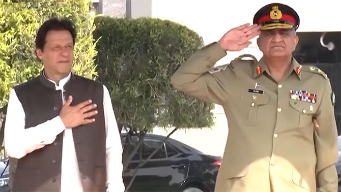 Pakistan's army chief General Qamar Javed Bajwa, right, with Prime Minister Imran Khan, August 31, 2018