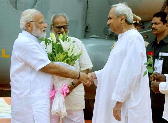 Odisha Chief Minister Naveen Patnaik, right, greets Prime Minister Narendra Damodardas Modi