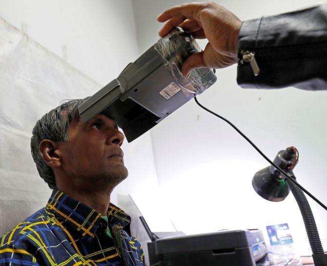 SC upholds Aadhaar, says it's not needed for cellphones, banks