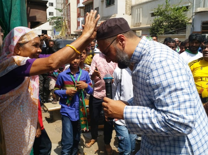 Asaduddin Owaisi is blessed by a voter during his padyatra in Aurangabad. Photograph: SnapsIndia