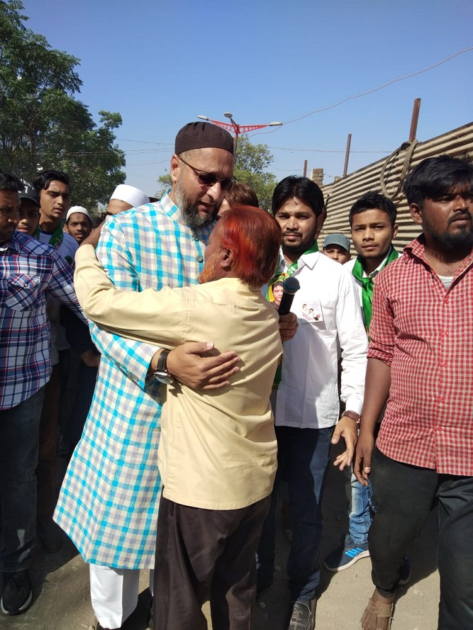 Asaduddin Owaisi embraces a voter during his padyatra in Aurangabad