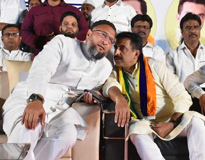 Imtiaz Jaleel, the AIMIM's candidate for the Lok Sabha election in Aurangabad, right, whispers to AIMIM President Asaduddin Owaisi.