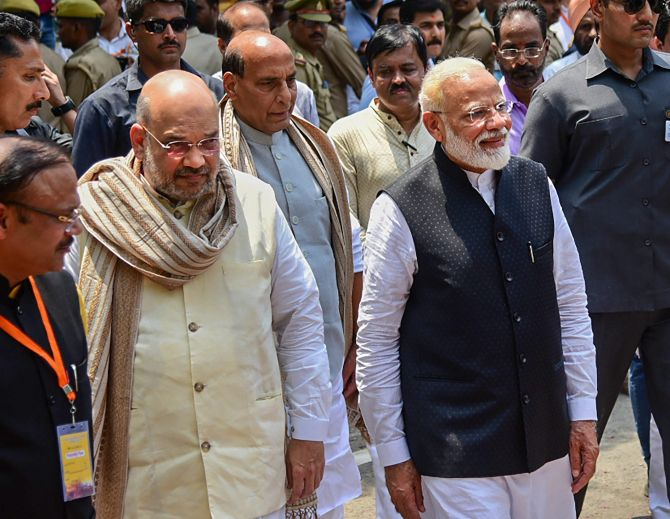 Escorted by Home Minister Rajnath Singh, centre, and Bharatiya Janata Party national President Amit Anilchandra Shah, Prime Minister Narendra Damodardas Modi walks to file his nomination to contest the Lok Sabha election in Varanasi, April 26, 2019