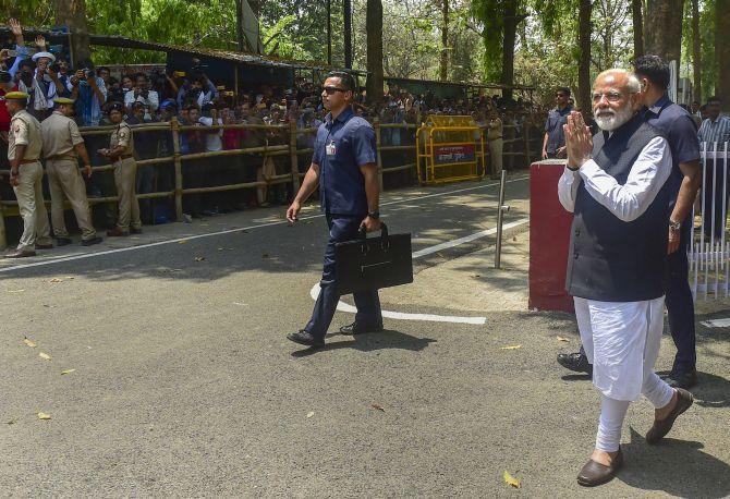 Prime Minister Narendra Damodardas Modi greets crowds after filing his nomination papers in Varanasi, April 26, 2019. Photograph: Mahender Vashisht/PTI Photo