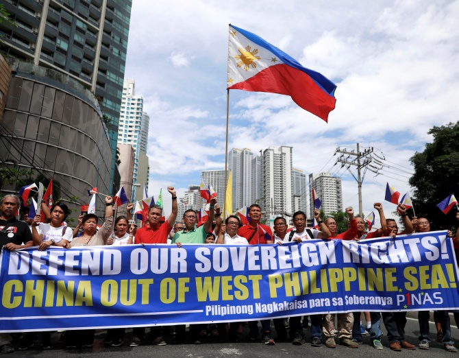 Filipino activists and opposition leaders march to protest against the presence of Chinese vessels in South China Sea at the Chinese Embassy in Makati City, Philippines, April 9, 2019
