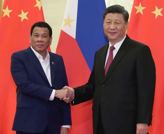 Philippine President Rodrigo Duterte with Chinese President Xi Jinping in Beijing, China