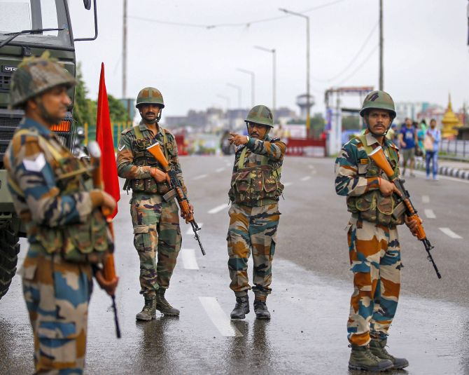 Army personnel stand guard in Jammu on Aug 5, 2019.