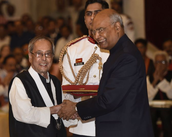 President Ram Nath Kovind confers the Bharat Ratna upon former President Pranab Mukherjee at Rashtrapati Bhavan, August 8, 2019. Photograph: Kamal Singh/PTI Photo