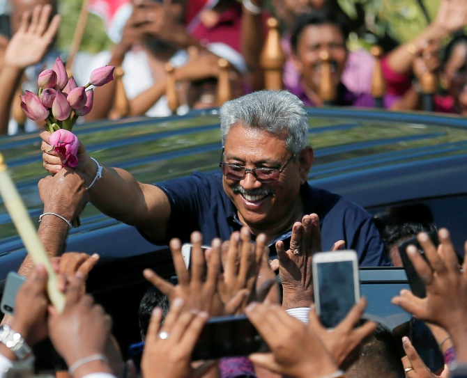 Sri Lanka's former defense secretary Gotabaya Rajapaksa greets his supporters after his return from the United States