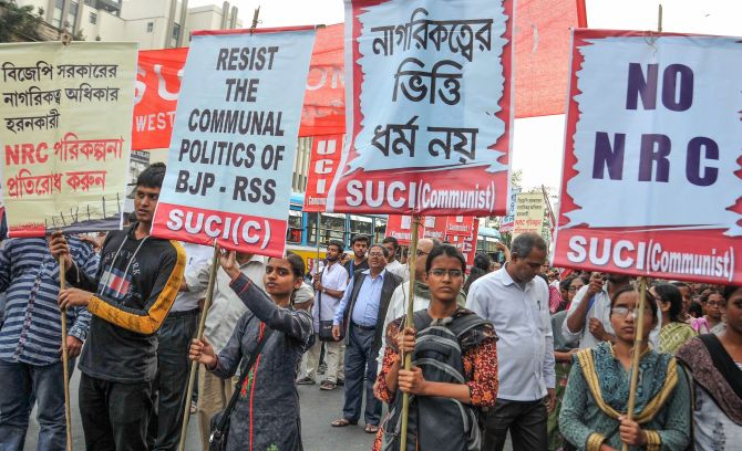 Activists of SUCI (Communist) raise slogans during a protest rally against NRC (National Register of Citizens) and Citizenship (Amendment) Bill, in Kolkata, on Tuesday