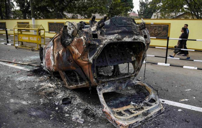 Frenzied mobs blocked roads with burning tyres and menaced commuters by bludgeoning their vehicles with sticks and stones. Photograph: PTI Photo