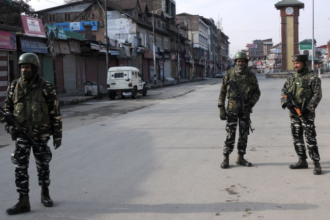 Security personnel guard a blocked road during a strike called in Srinagar during Prime Minister Narendra Damodardas Modi's visit, February 3, 2019. Photograph: Umar Ganie for Rediff.com