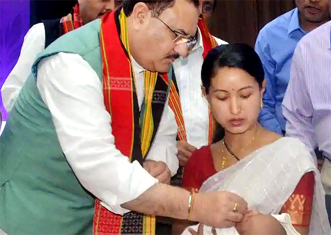 Then Union health minister Jagat Prasad Nadda administers the rotavirus vaccine in Agartala. Photograph: PTI
