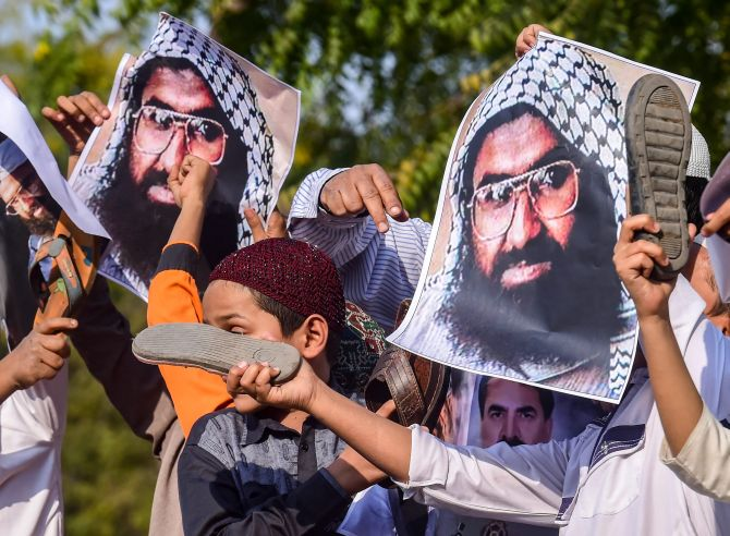 Protesters beat posters of Jaish-e-Mohammed terrorist Masood Azhar in Ahmedabad, February 15, 2019. Photograph: Santosh Hirlekar/PTI Photo