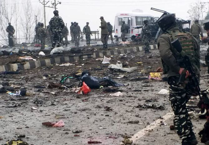 Body parts strewn around the area of the blast in Pulwama