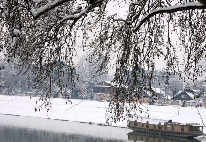 Kashmiris on a snowy day in Srinagar