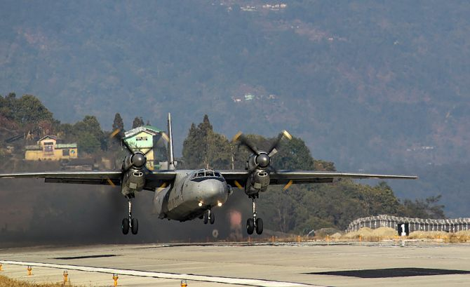IMAGE: An AN-32 aircraft  lands at Pakyong airfield in Pakyong, on Wednesday. This is the first landing by an AN-32 class of aircraft at the airfield, one of the highest airfields in India. Photograph: PTI Photo